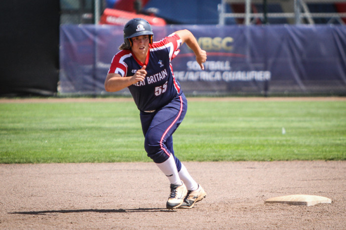 GB Women's Fastpitch Team runner taking off from the base