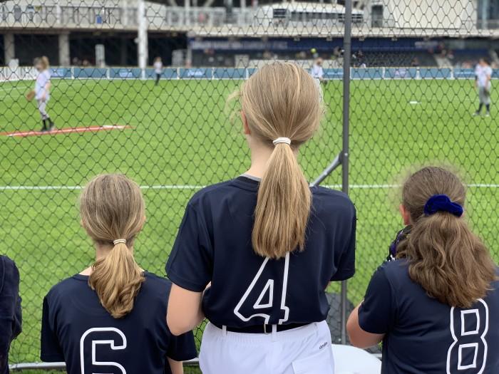 Girls playing and watching softball